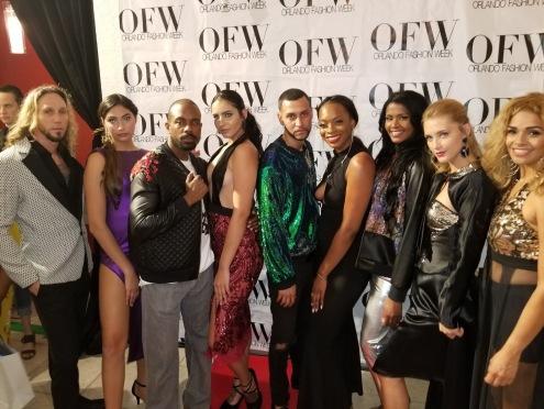 Designer, Victor Sanchez, stands along side models and The Rose Carpet Media Groups own, Kelaiah Rose at OFW 2018.