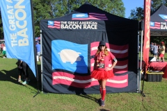 The Great American Bacon Race participants pose for the camera after a sizzlin' race.