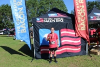 The Great American Bacon Race participants celebrate with photos and laughter, but mostly bacon, as they show off their Bacon themed medals. Mackenzie placed as one of the fastest participants in her age and gender category, granting her the prized Golden Pig.